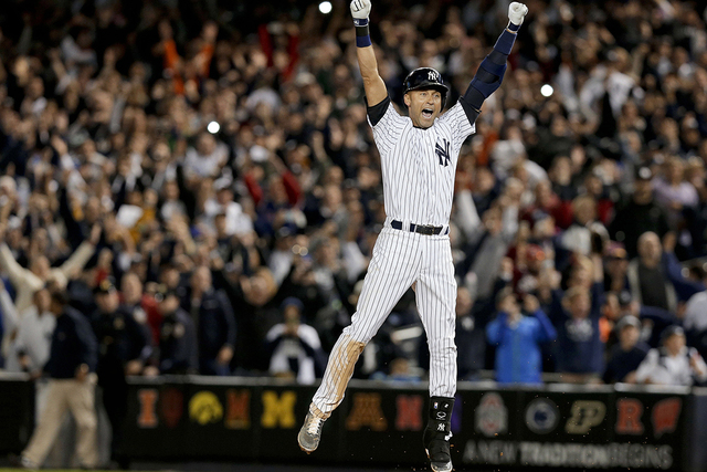 In this Sept. 25, 2014, file photo, New York Yankee Derek Jeter jumps after hitting the game-winning single against the Baltimore Orioles in the ninth inning of a baseball game, in New York. It wa ...