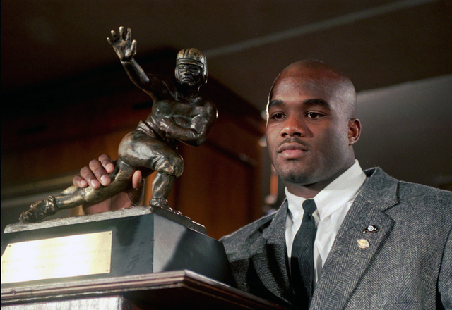 In this Dec. 10, 1994, file photo, Colorado's Rashaan Salaam poses with his 1994 Heisman Trophy at the Downtown Athletic Club in New York. Authorities say Rashaan Salaam has been found dead in a p ...