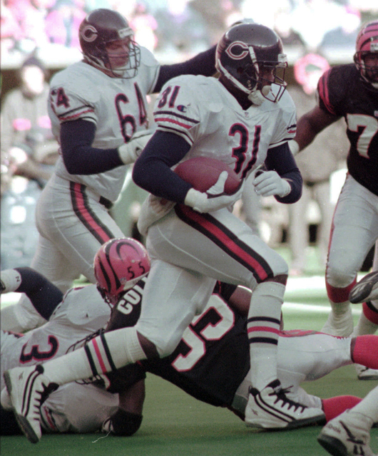 In this Dec. 10, 1995, file photo, Chicago Bears running back Rashaan Salaam breaks through the line against the Cincinnati Bengals during an NFL game in Cincinnati. Salaam had a terrific rookie s ...