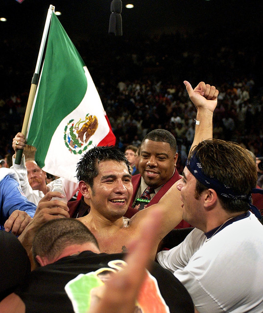 In this June 22, 2002, file photo, Mexico's Marco Antonio Barrera, center, celebrates following his WBC featherweight title fight against Erik Morales at the MGM Grand Hotel and Casino in Las Vega ...