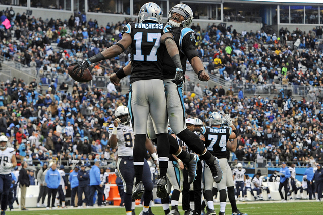 Carolina Panthers' Devin Funchess (17) celebrates with Cam Newton (1) after a touchdown against the San Diego Chargers in the first half of an NFL football game in Charlotte, N.C., Sunday, Dec. 11 ...