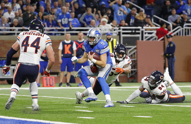 Detroit Lions quarterback Matthew Stafford (9) runs for a 7-yard touchdown against the Chicago Bears in the second half of an NFL football game in Detroit, Sunday, Dec. 11, 2016. (Rick Osentoski/AP)