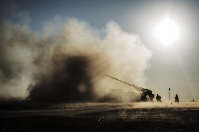 French soldiers shoot a canon toward Islamic State militant positions from a coalition forces military base in Qayara, Iraq, Saturday, Dec. 10, 2016. An Iraqi commander says reinforcements have be ...