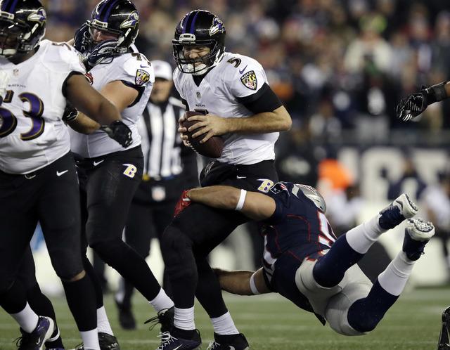 New England Patriots defensive end Rob Ninkovich (50) sacks Baltimore Ravens quarterback Joe Flacco (5) during the second half of an NFL football game, Monday, Dec. 12, 2016, in Foxborough, Mass.  ...
