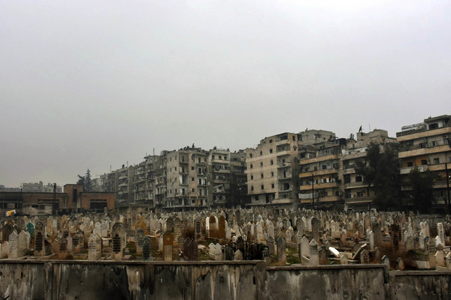 This photo released by the Syrian official news agency SANA, shows a graveyard in east Aleppo, Syria, Tuesday, Dec. 13, 2016. Syrian rebels said Tuesday that they reached a cease-fire deal with Mo ...