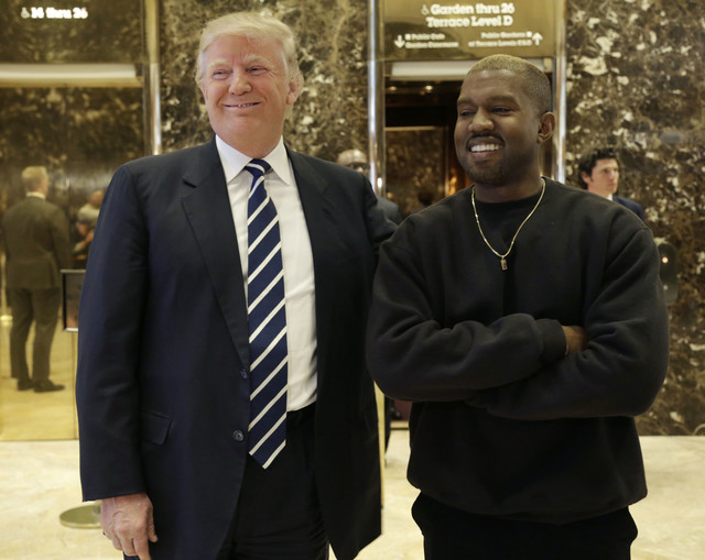 President-elect Donald Trump and Kanye West pose for a picture in the lobby of Trump Tower in New York, Tuesday, Dec. 13, 2016. (Seth Wenig/AP)