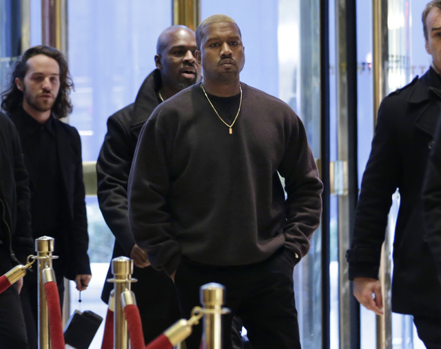 Kanye West enters Trump Tower in New York, Tuesday, Dec. 13, 2016. (Seth Wenig/AP)