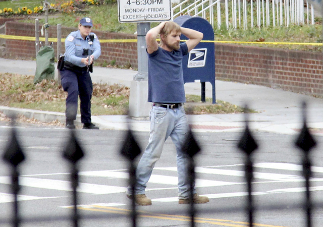 In this Dec. 4, 2016, file photo, Edgar Maddison Welch, 28 of Salisbury, N.C., surrenders to police in Washington. Welch, who fired an assault riffle multiple times inside a pizza restaurant in th ...