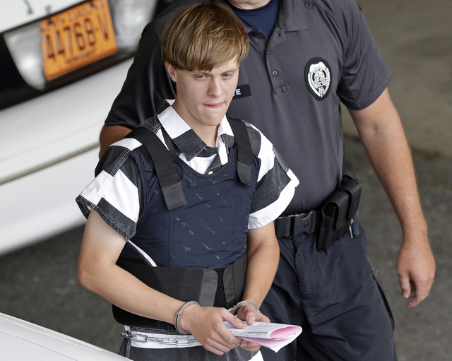 In this June 18, 2015 file photo, Charleston, S.C., shooting suspect Dylann Storm Roof is escorted from the Cleveland County Courthouse in Shelby, N.C. Prosecutors who wanted to show that Roof was ...