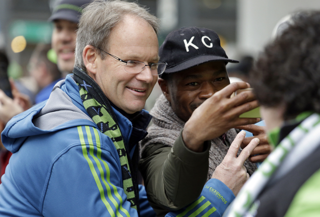 Seattle Sounders head coach Brian Schmetzer smiles for a photo before a march and rally celebrating the team's MLS Cup Championship Tuesday, Dec. 13, 2016, in Seattle. Seattle beat Toronto FC 5-4  ...