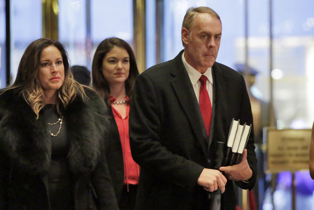Rep. Ryan Zinke, right, R-Mont., arrives in Trump Tower, in New York, Monday, Dec. 12, 2016. (Richard Drew/AP)
