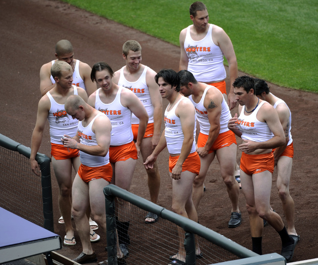 In this Sept. 17, 2008, file photo, rookie members of the San Diego Padres baseball team are dressed like waitpeople at a Hooter's restaurant, as part of rookie hazing after the Padres' 1-0 loss t ...