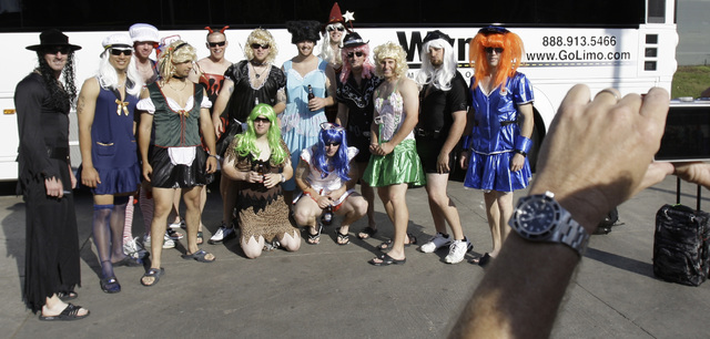 In this Sept. 24, 2008, file photo, Oakland Athletics rookie players dressed in costumes line up for a group photo before boarding the team bus after their 14-4 loss to the Texas Rangers, in Arlin ...