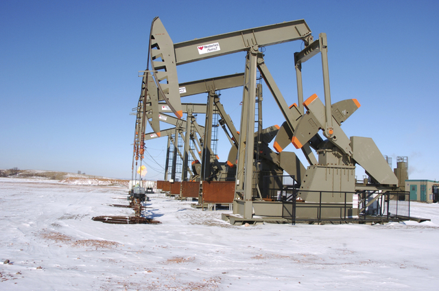 FILE- This Feb. 26, 2015 photo, shows an oil well on the Fort Berthold Indian Reservation near Mandaree, N.D. For conservatives who have long believed federal managers of America's vast public lan ...