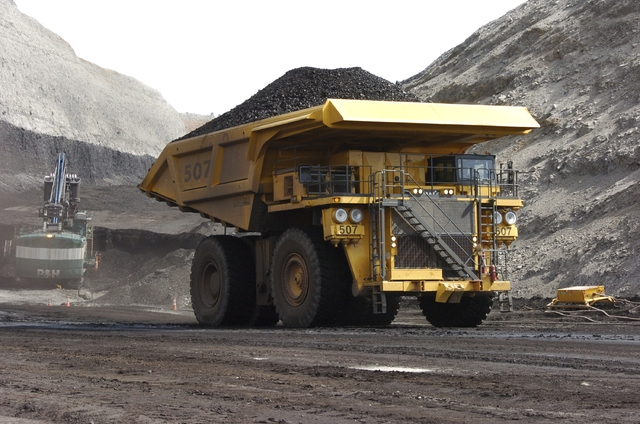 FILE - In this April 4, 2013, file photo, a mining dumper truck hauls coal at Cloud Peak Energy's Spring Creek strip mine near Decker, Mont. For conservatives who have long believed federal manage ...