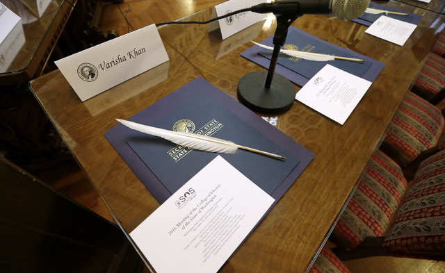 Quill ballpoint pens sit ready for Elector College electors, Monday, Dec. 19, 2016, in Olympia, Wash. Members of Washington state's Electoral College met at noon Monday in the Capitol to complete  ...