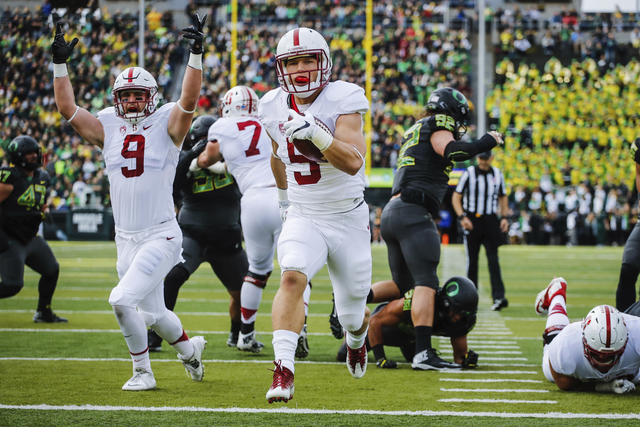 In this Nov. 12, 2016, file photo, Stanford running back Christian McCaffrey (5) runs for a touchdown in the first quarter of an NCAA college football game, in Eugene, Ore. McCaffrey is done playi ...