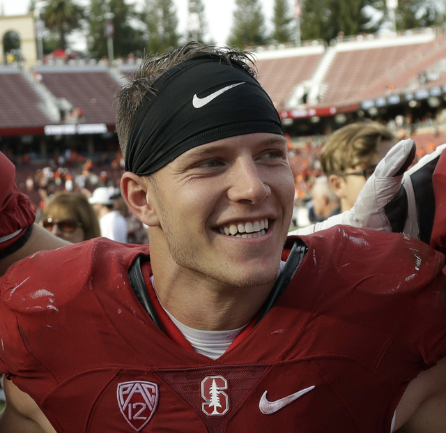 In this Nov. 5, 2016, file photo, Stanford running back Christian McCaffrey (5) smiles after Stanford defeated Oregon State, 26-15, in an NCAA college football game, in Stanford, Calif. McCaffrey  ...