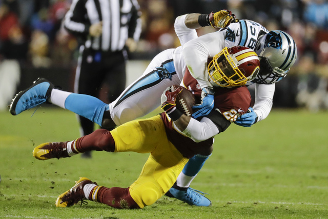 Carolina Panthers outside linebacker Thomas Davis (58) stops Washington Redskins running back Chris Thompson (25) during the first half of an NFL football game in Landover, Md., Monday, Dec. 19, 2 ...
