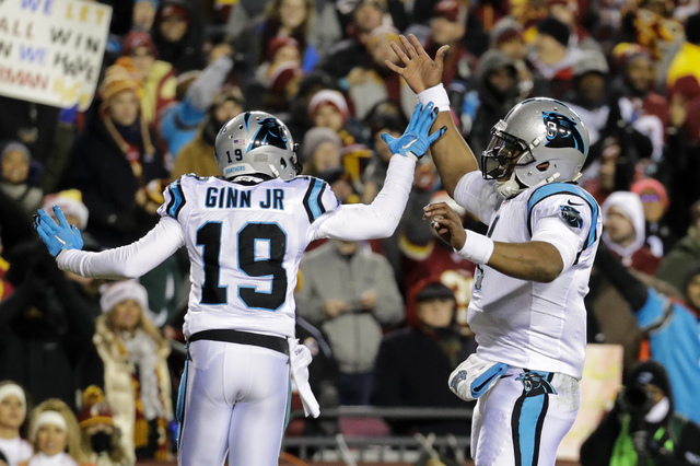 Carolina Panthers quarterback Cam Newton (1) celebrates wide receiver Ted Ginn's (19) touchdown reception during the first half of an NFL football game against the Washington Redskins in Landover, ...