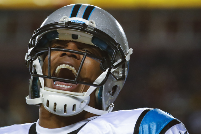 Carolina Panthers quarterback Cam Newton (1) celebrates wide receiver Ted Ginn's touchdown during the first half of an NFL football game against the Washington Redskins in Landover, Md., Monday, D ...