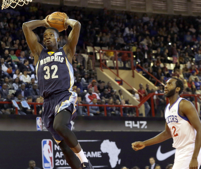 In this Aug. 1, 2015 file photo, Team World's Jeff Green of Memphis Grizzlies, left, goes up for a shot as Team Africa's Luc Mbah a Moute  from Cameroon , looks on during the NBA Africa Game at El ...