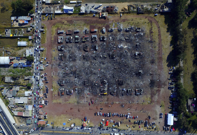 A fireworks market lays in ruins one day after an explosion at the San Pablito Market in Tultepec on the outskirts of Mexico City, Wednesday, Dec. 21, 2016. The market was especially well stocked  ...