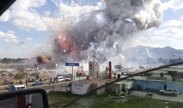 This image made from video recorded from a passing car shows an explosion ripping through the San Pablito fireworks' market in Tultepec, Mexico, Tuesday, Dec. 20, 2016. Sirens wailed and a heavy s ...