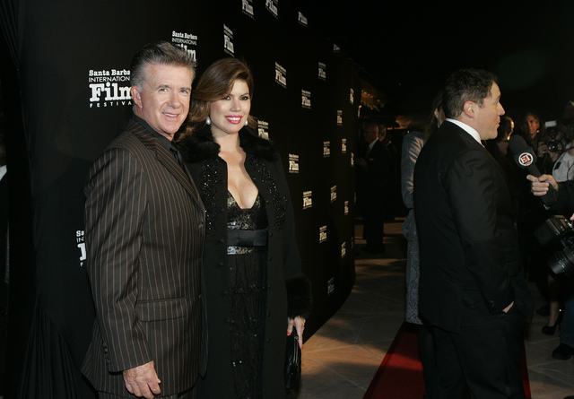 In this Nov. 19, 2010, file photo, Alan and Tanya Thicke pose on the red carpet before Santa Barbara International Film Festival. Tanya Thicke says her husband was laid to rest Monday, Dec. 19, 20 ...