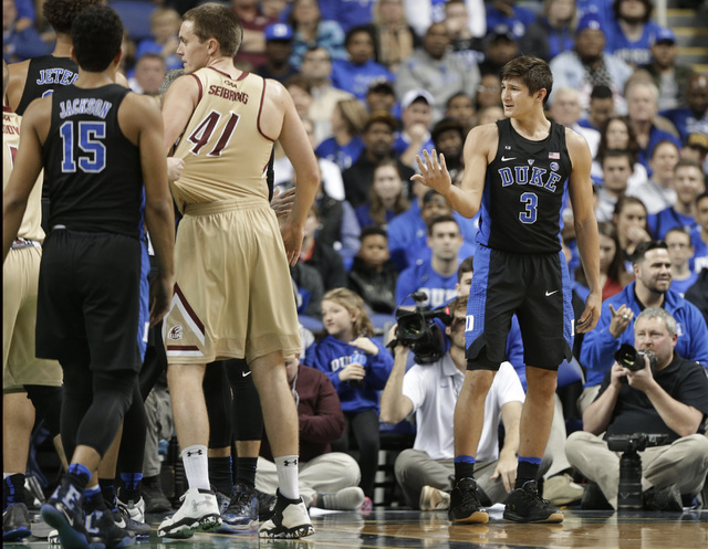 Duke's Grayson Allen (3) reacts after being called for a foul from tripping a Elon player in the first half of an NCAA college basketball game in Greensboro, N.C., Wednesday, Dec. 21, 2016. (AP Ph ...