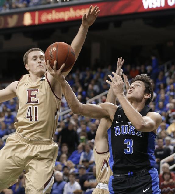 Duke's Grayson Allen (3) shoots over Elon's Tyler Seibring (41) in the first half of an NCAA college basketball game in Greensboro, N.C., Wednesday, Dec. 21, 2016. (AP Photo/Chuck Burton)