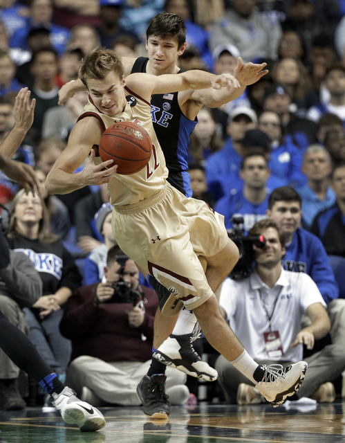 Elon's Steven Santa Ana (22) is tripped by Duke's Grayson Allen (3) in the first half of an NCAA college basketball game in Greensboro, N.C., Wednesday, Dec. 21, 2016. Allen was called for a techn ...