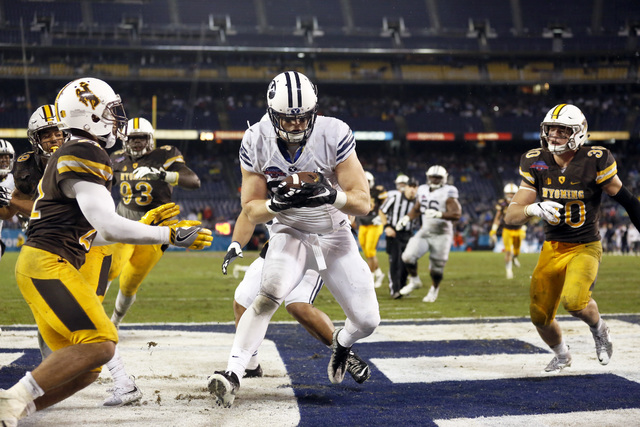 BYU tight end Tanner Balderree, center, catches the ball in the end zone for a touchdown against Wyoming during the first half of the Poinsettia Bowl NCAA college football game Wednesday, Dec. 21, ...