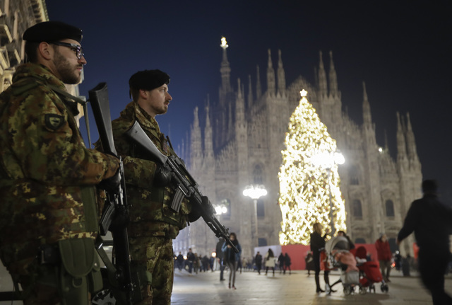 Italian soldiers patrol next to Milan's gothic cathedral, Italy, Thursday, Dec. 22, 2016. Following the truck attack on a Christmas market in Berlin, Italy is strengthening security measures for a ...