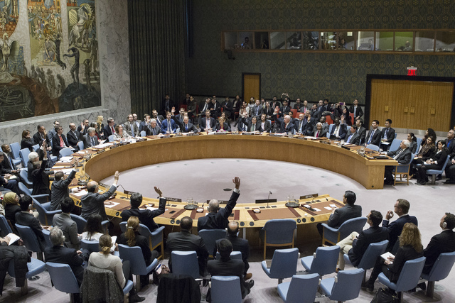 In this photo provided by the United Nations, members of the United Nations Security council vote at the United Nations headquarters on Friday, Dec. 23, 2016, in favor of condemning Israel for its ...