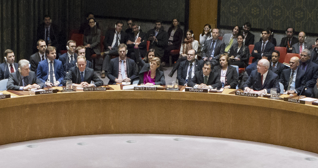In this photo provided by the United Nations, Samantha Power, center, the United States Ambassador to the United Nations, votes to abstain during a U.N. Security Council vote on condemning Israel' ...