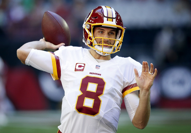FILE - In this Sunday, Dec. 4, 2016, file photo, Washington Redskins quarterback Kirk Cousins (8) warms up prior to an NFL football game against the Arizona Cardinals in Glendale, Ariz. The Redski ...