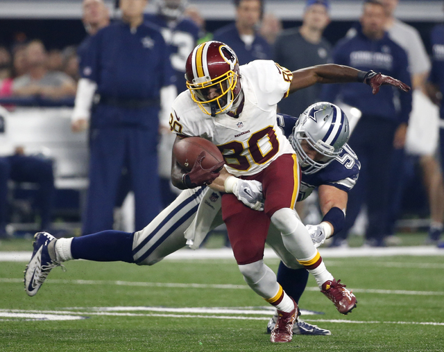 FILE - In this Thursday, Nov. 24, 2016 file photo, Washington Redskins wide receiver Jamison Crowder (80) attempts to escape a tackle by Dallas Cowboys' Sean Lee (50) during the second half of an  ...