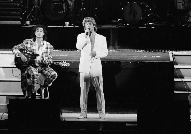FILE - In this April 7, 1985 file photo, George Michael and Andrew Ridgeley of the British group WHAM! perform during a concert in Peking, China. Michael, who rocketed to stardom with WHAM! and we ...