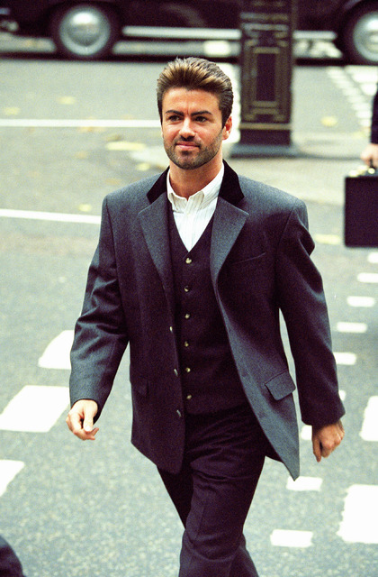 FILE - In this Oct. 28, 1993, file photo, pop star George Michael arrives to give evidence at the Royal Courts of Justice in London. Michael was petitioning the court to release him from his contr ...