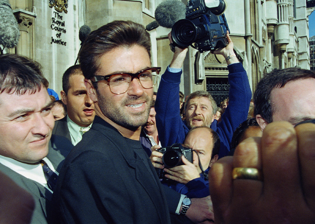 FILE - In this Monday, Oct. 18, 1993, file photo, pop star George Michael, 30, outside the Royal Courts of Justice in London at the start of his court action against Sony Music Entertainment (UK)  ...