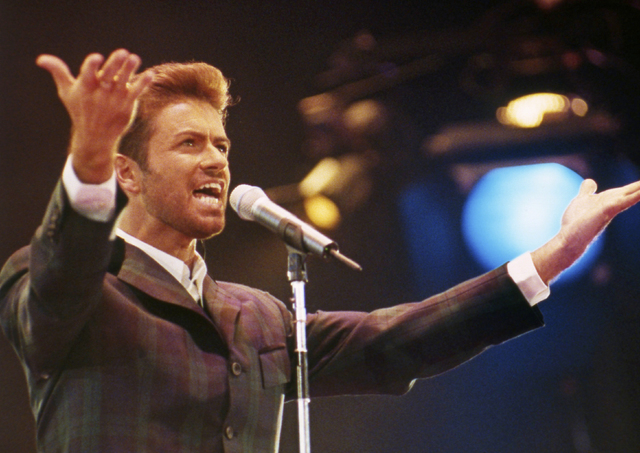 """FILE - In this Dec. 2, 1993 file photo, George Michael performs at """"Concert of Hope"""" to mark World AIDS Day at London's Wembley Arena. According to a publicist on Sunday, Dec. 25 ..."""