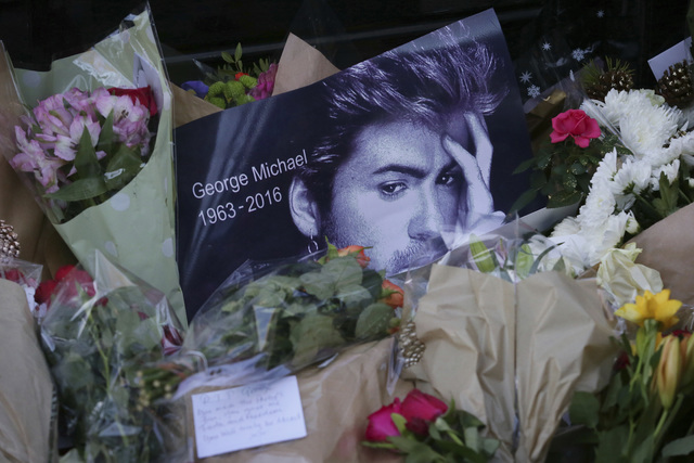 This Monday, Dec. 26, 2016, photo shows tributes left outside the home of British musician George Michael in London. Michael, who rocketed to stardom with WHAM! and went on to enjoy a long and cel ...