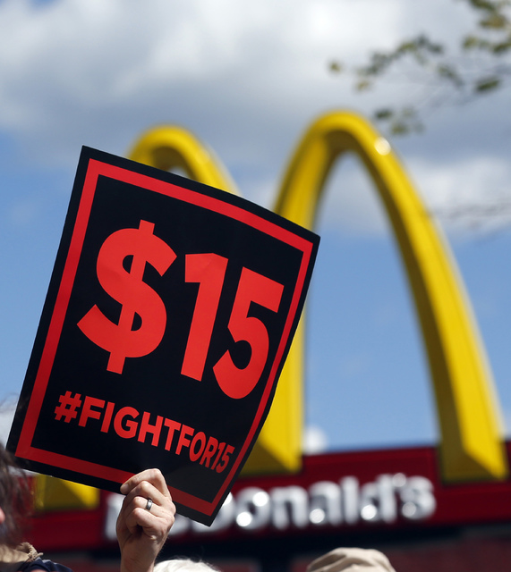 In this July 22, 2015, photo, supporters of a $15 minimum wage for fast food workers rally in front of a McDonald's in Albany, N.Y. (Mike Groll/File, AP)
