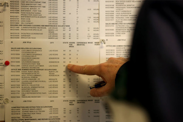 A man checks the employment board at Nevada JobConnect in Henderson. (Las Vegas Review-Journal)