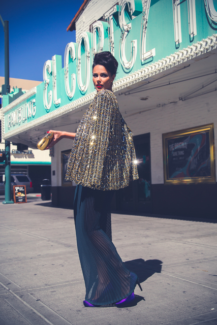 """In an image from """"Lost in Las Vegas,"""" a model wears a pleated skirt by Ermelinda Manos and holds a clutch from Manos' mother's closet. Courtesy."""