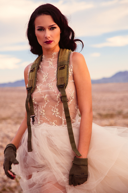 """In an image from """"Lost in Las Vegas,"""" a model wears one of Ermelinda Manos' designs and a vintage US military parachute in reference to Miss Atomic Bomb. Courtesy."""