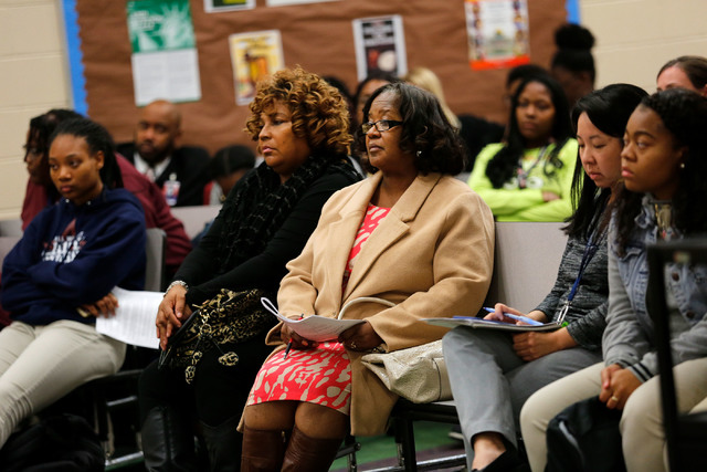 Robin Harris, elementary school principal of Andre Agassi College Preparatory Academy, third from right, attends a Governing Board meeting at the academy in Las Vegas, Tuesday, Dec. 13, 2016. (Chi ...