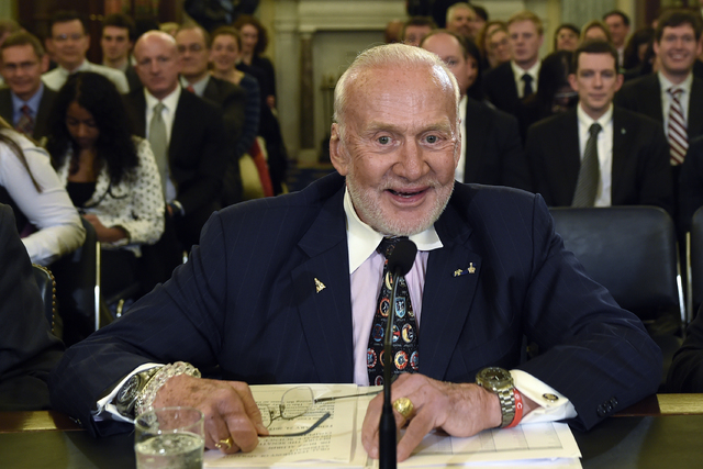 In this Tuesday, Feb. 24, 2015, file photo, Buzz Aldrin, former NASA Astronaut and Apollo 11 Pilot, prepares to testify on Capitol Hill in Washington, before the Senate subcommittee on Space, Scie ...