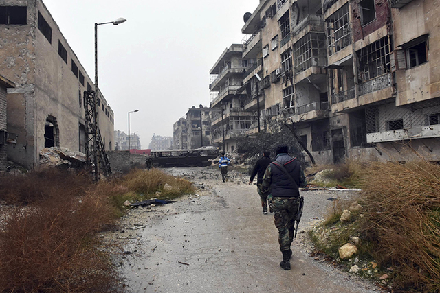 yrian troops and pro-government gunmen march through the streets of east Aleppo, Syria, Tuesday, Dec. 13, 2016. (SANA via AP)